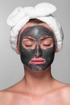 adult-woman-enjoying-face-mask_23-2148272552