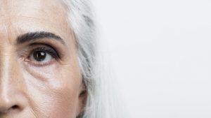close-up-half-face-senior-woman_23-2148277955