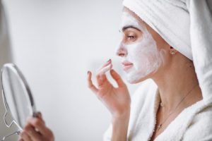 woman-applying-beauty-mask_1303-13041