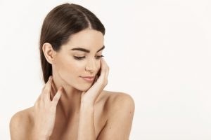 woman-with-hands-her-neck-looking-down_23-2147647715