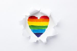 rainbow-heart-smashing-through-layers-white-paper_23-2148475894